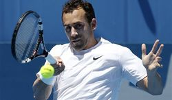 Bobby Reynolds of the United States plays a shot in his match against fellow countryman John Isner on the fourth day of play at the Sydney International tennis tournament in Sydney, Australia, Wednesday, Jan. 11, 2012. (AP Photo/Rob Griffith)