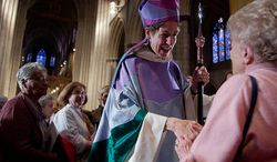 ** FILE ** The Most Rev. Katharine Jefferts Schori is invested as the presiding bishop of the Episcopal Church at the Washington National Cathedral in 2006. (The Washington Times)