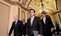 House Majority Leader Eric Cantor (center), Virginia Republican, walks July 11, 2012, from the House floor on Capitol Hill as he manages the vote to repeal the Affordable Care Act. (Associated Press)