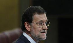Spanish Prime Minister Mariano Rajoy speaks to the parliament in Madrid on Wednesday, July 11, 2012. (AP Photo/Andres Kudacki)