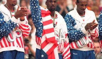 Michael Jordan (center), Scottie Pippen (left) and Clyde Drexler were part of a U.S. basketball team that obliterated the competition in the 1992 Olympics. (Associated Press)