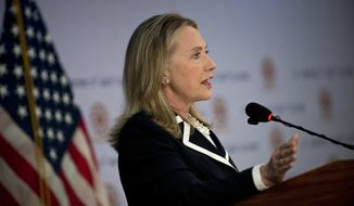 Secretary of State Hillary Rodham Clinton speaks during a press conference at the Peace Palace in Phnom Penh, Cambodia, on Thursday, July 12, 2012. (AP Photo/Brendon Smialowski, Pool)