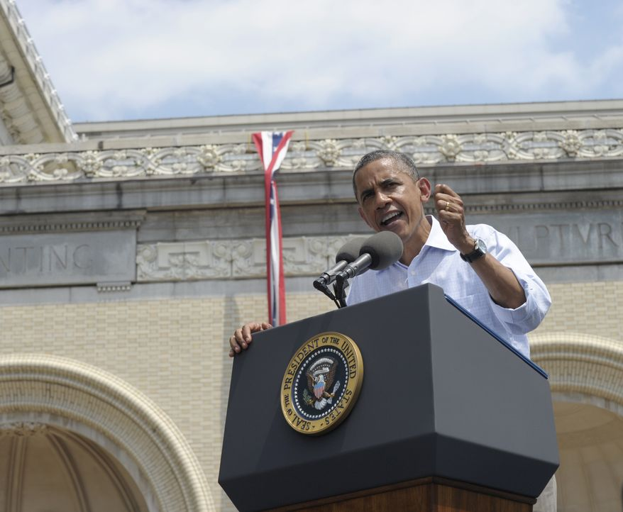 President Obama speaks at Carnegie Mellon University in Pittsburgh on Friday, July 6, 2012, while on a two-day campaign swing by bus through Ohio and Pennsylvania. The presidential seal adorns the lectern. (AP Photo/Susan Walsh)