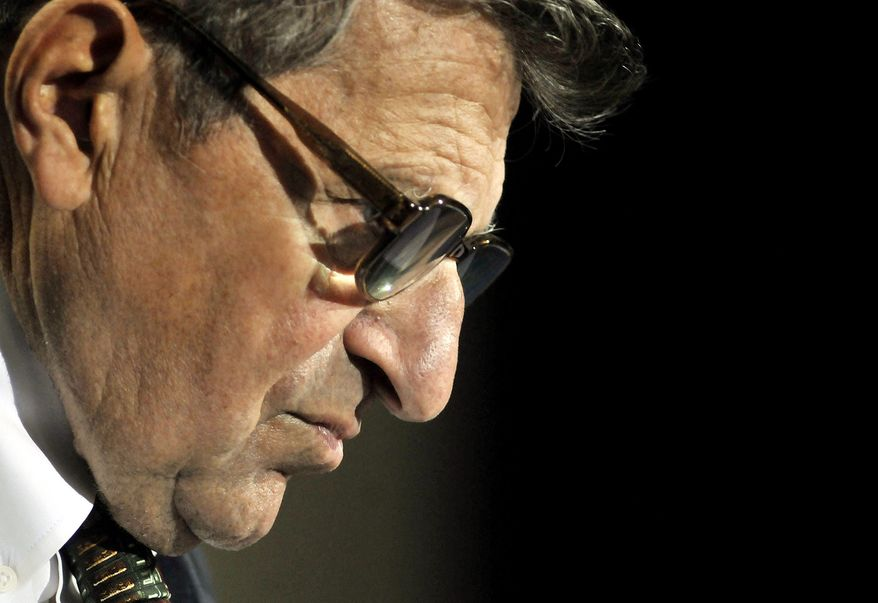 ** FILE ** In this Sept. 30, 2008, file photo, Penn State football coach Joe Paterno listens to a question during his weekly news conference in State College, Pa. (AP Photo/Pat Little)
