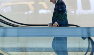 JPMorgan Chase CEO Jamie Dimon enters the company headquarters, Friday, July 13, 2012, in New York. (AP Photo/Jin Lee)