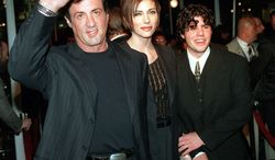 """** FILE ** In this Dec. 5, 1996, file photo, Sylvester Stallone, left, star of the film """"Daylight,"""" arrives at the film's world premiere with his girlfriend Jennifer Flavin, center, and his son Sage Stallone, who co-stars in the film, in Hollywood district of Los Angeles. A publicist for Sylvester Stallone says the actor's son has died on Friday, July 13, 2012, at age 36. (AP Photo/Kevork Djansezian, File)"""