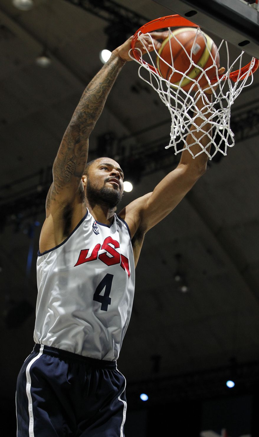 USA Basketball center Tyson Chandler dunks the ball during practice, Saturday, July 14, 2012, in Washington. (AP Photo/Alex Brandon)