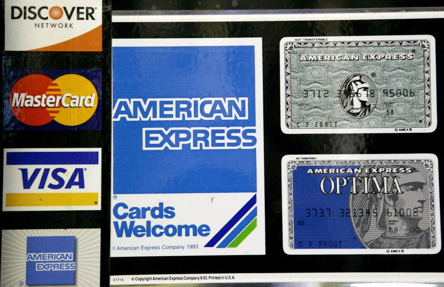 ** FILE ** This Sept. 5, 2007, file photo shows credit card decals on a store window in the Hollywood section of Los Angeles. Visa, MasterCard and major banks agreed to pay retailers at least $6 billion to settle a long-running lawsuit that alleged the card issuers conspired to fix the fees that stores pay to accept credit cards. (AP Photo/Nick Ut, File)