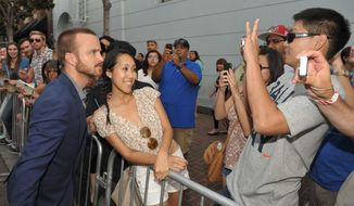 "Aaron Paul greets fans at AMC's ""Breaking Bad"" premiere and after party on July 14, 2012 in San Diego. (John Shearer/Invision for AMC/Associated Press)"