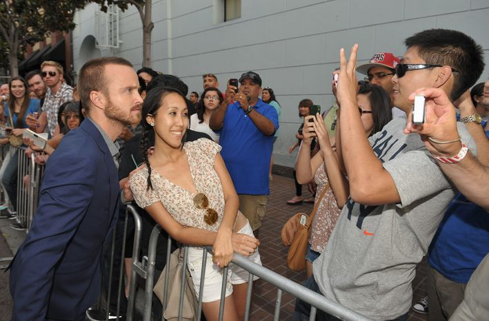"""Aaron Paul greets fans at AMC's """"Breaking Bad"""" premiere and after party on July 14, 2012 in San Diego. (John Shearer/Invision for AMC/Associated Press)"""
