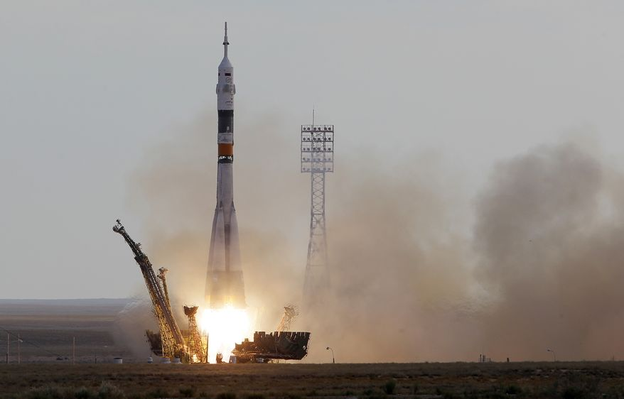 A Soyuz-FG rocket booster with a Soyuz TMA-05M spaceship carrying a new crew to the International Space Station blasts off from the Russian-leased Baikonur cosmodrome in Kazakhstan on Sunday, July 15, 2012. (AP Photo/Dmitry Lovetsky)