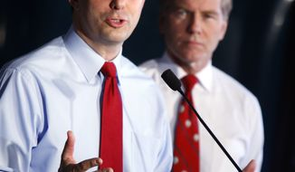Wisconsin Gov. Scott Walker (left) and Virginia Gov. Bob McDonnell appear at a news conference at Copland Trucking in Williamsburg, Va., on Friday, July 13, 2012, before the start of the National Governors Association meeting. (AP Photo/Richmond Times-Dispatch, Bob Brown)