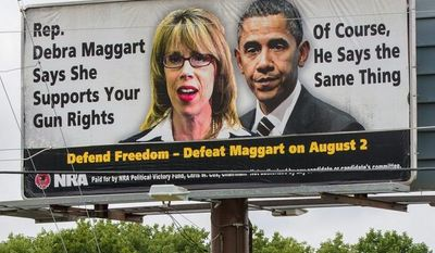 An NRA billboard in Hendersonville, Tenn., attacks state Rep. Debra Maggart. The group has had a falling out with Republican lawmakers in Tennessee over a bill seeking to guarantee workers the right to store their guns in their cars while at work. (Associated Press)