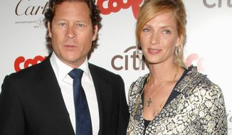 **FILE** Actress Uma Thurman (right) and financier Arpad Busson attend the Cookie magazine Smart Cookie awards in New York on April 20, 2009. (Associated Press)