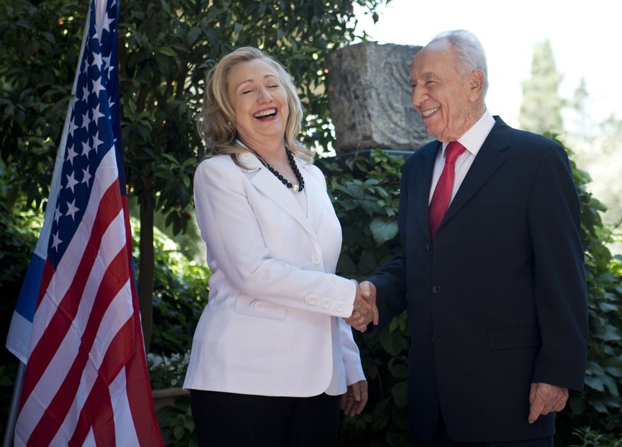Israeli President Shimon Peres (right) and U.S. Secretary of State Hillary Rodham Clinton share a laugh before their meeting at the president's residence in Jerusalem on Monday, July 16, 2012. (AP Photo/Brendan Smialowski, Pool)