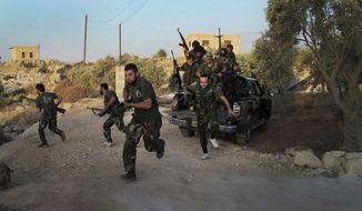 Free Syrian Army soldiers run for cover in Idlib province in northern Syria in this image taken by a citizen journalist on Friday, July 13, 2012. (AP Photo/Edlib News Network)