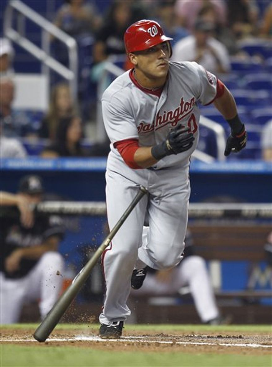 Washington Nationals' Ian Desmond runs to first on an RBI single in the first inning of a baseball game against the Miami Marlins in Miami, Friday, July 13, 2012. (AP Photo/J Pat Carter)