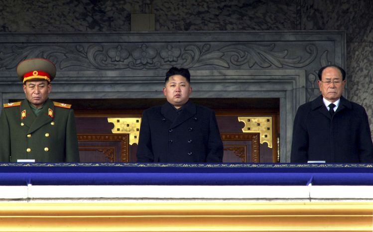 **FILE** North Korean leader Kim Jong-un (center), flanked by Kim Yong-nam (right), president of the Presidium of the Supreme People's Assembly and the ceremonial head of state, and Vice Marshal Ri Yong-ho of the Korean People's Army, presides over a national memorial service for his late father, Kim Jong-il, at Kim Il-sung Square in Pyongyang, North Korea, on Dec. 29, 2011. (Associated Press)