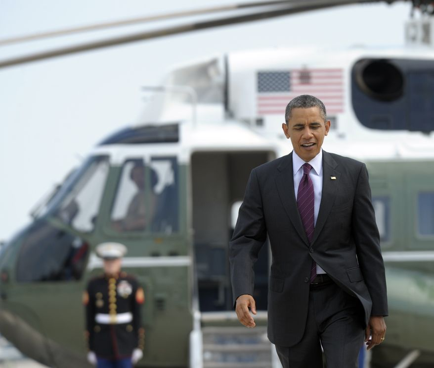 President Obama heads from Marine One to Air Force One at Andrews Air Force Base in Maryland on July 16, 2012. (Associated Press)