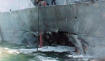 This October 2000 image, provided by the U.S. Navy, shows damage sustained by the USS Cole after a terrorist bomb exploded during a refueling operation in the port of Aden, Yemen. Osama bin Laden was blamed for the attack.