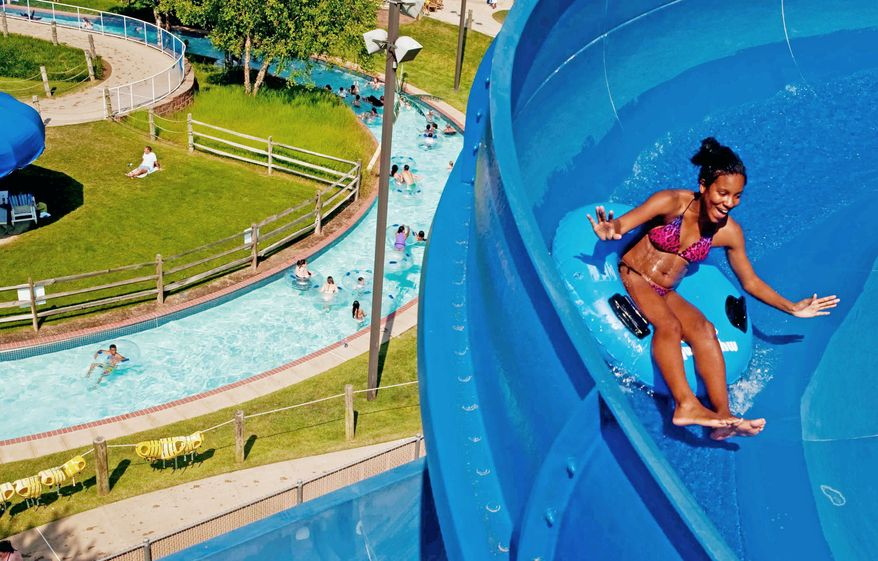 Dominique Colbert of Culpeper, Va., rides to the bottom of Pipeline Tower at Splashdown WaterPark while a heat advisory was in effect. (Raymond Thompson/The Washington Times)