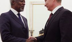 Russian President Vladimir Putin (right) and Kofi Annan, the U.N. envoy for the Syrian crisis, conferred in Moscow on Tuesday on efforts to end the fighting in Syria. (Associated Press)