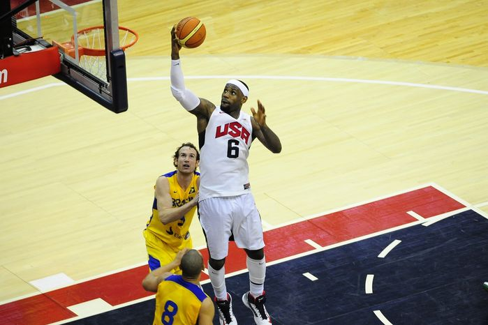 LeBron James heads to the hoop with a layup in the U.S. Olympic men's basketball team's win over Brazil on Monday, July 16th at Verizon Center. (The Washington Times)