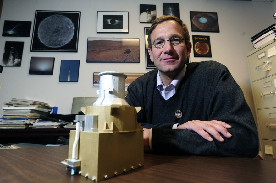 **FILE** Donald Hassler, science program director at the Southwest Research Institute, is seen June 9, 2011, in his Boulder, Colo., office with a full-size replica of an instrument that will be placed on the NASA Mars rover Curiosity. The instrument will collect data about radiation on the Martian surface. (Associated Press/The Boulder Camera)