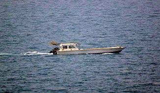 A photo provided by the U.S. Navy shows a small vessel that was fired upon by the U.S. Navy off Dubai's coast on Monday, July 16, 2012. (AP Photo/U.S. Navy)
