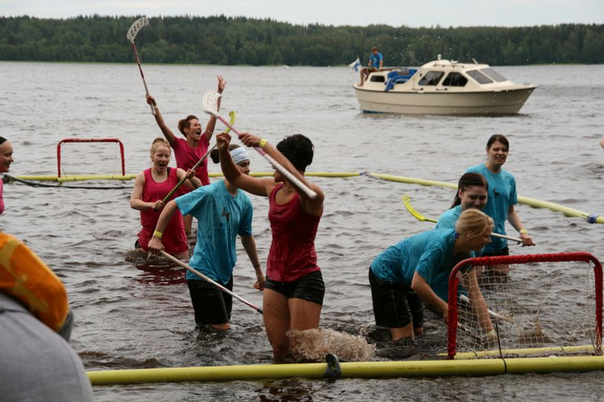 The open water floorball world championships are played in naural waters with a floating ball. The tournament takes place in Tammela, Finland. (Pekka Mertanen & Ville Lahde/Special to The Washington Times)