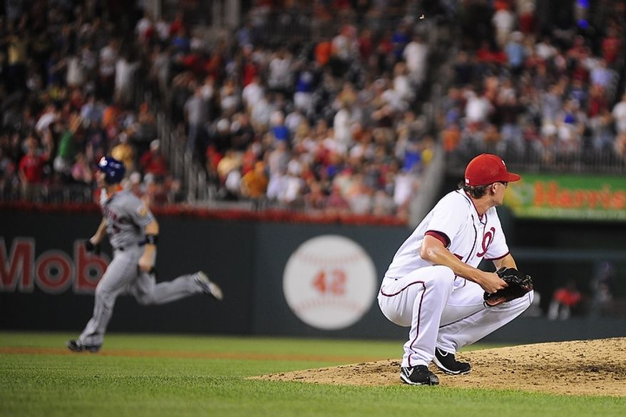 Tyler Clippard crouches in frustration after giving up a three run homer to Jordany Valdespin in the top of the ninth inning during the Washington Nationals game against the New York Mets at Nationals Park, Washington D.C.,Tuesday, July 17, 2012.   The homer gave the Mets a 3-2 lead in the top of the ninth.  (Ryan M.L. Young/The Washington Times)