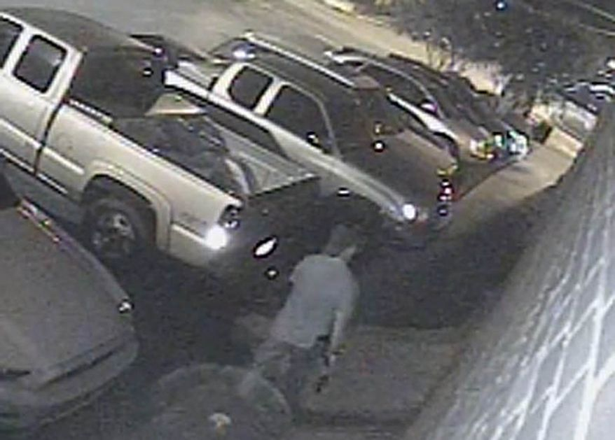 A suspected gunman walks near a Tuscaloosa, Ala., bar on Tuesday, July 17, 2012, in an image from surveillance video. Police say 17 people were wounded when a gunman opened fire outside a crowded bar. (AP Photo/Tuscaloosa Police Department)
