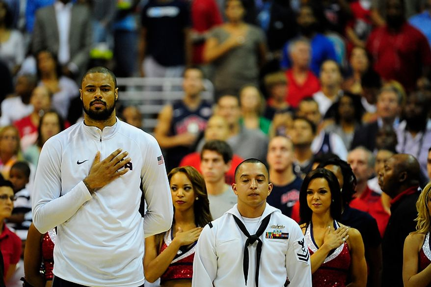 Team USA center Tyson Chandler stands at attention during the playing of the national anthem before an exhibition game July 16, 2012, between the U.S. men's basketball team and Brazil at Verizon Center in D.C. (Ryan M.L. Young/The Washington Times)