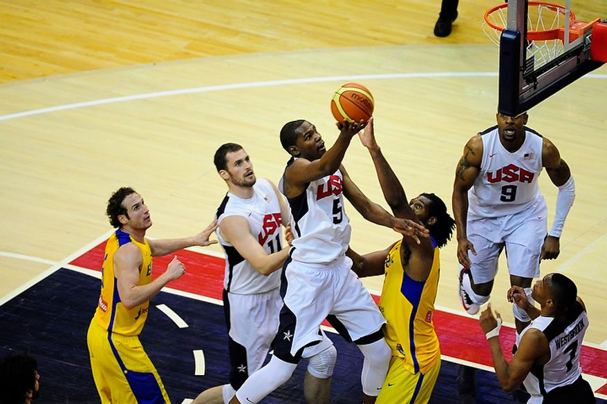Team USA forward Kevin Durant (5) drives to the basket during an exhibition game July 16, 2012, between the U.S. men's basketball team and Brazil at Verizon Center in D.C. (Ryan M.L. Young/The Washington Times)