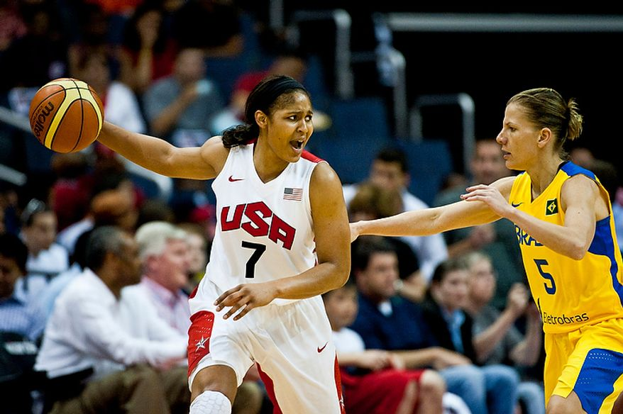 Team USA forward Maya Moore (7) calls out a play while dribbling against Brazil's Karla Cristina Martins Da Costa during an exhibition game July 16, 2012, between the U.S. women's basketball team and Brazil at Verizon Center in D.C. (Ryan M.L. Young/The Washington Times)