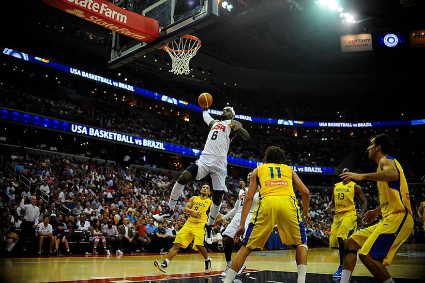 Team USA forward LeBron James (6) dunks during an exhibition game July 16, 2012, between the U.S. men's basketball team and Brazil at Verizon Center in D.C. (Ryan M.L. Young/The Washington Times)