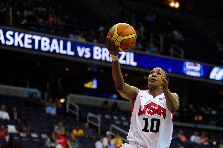 Team USA forward Tamika Catchings attempts a layup during an exhibition game July 16, 2012, between the U.S. women's basketball team and Brazil at Verizon Center in D.C. (Ryan M.L. Young/The Washington Times)
