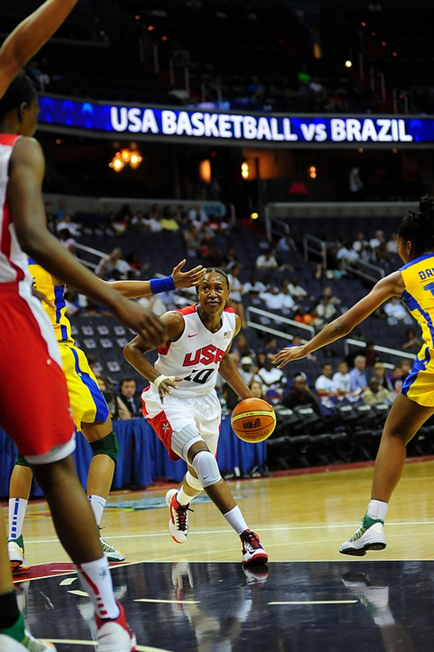 Team USA forward Tamika Catchings (10) dribbles through traffic during an exhibition game July 16, 2012, between the U.S. women's basketball team and Brazil at Verizon Center in D.C. (Ryan M.L. Young/The Washington Times)