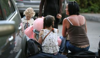 A family waits near Burgas airport, shortly after a bomb attack against a bus with Israeli tourists, outside the Black Sea city of Burgas, Bulgaria, some 400 kilometers (250 miles) east of the capital, Sofia, Wednesday, July 18, 2012. A bus carrying Israeli tourists in the Bulgarian resort city of Burgas exploded Wednesday killing at least three people and wounding more than 20 others, police said. (AP Photo/ Impact press Group)