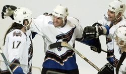 Calle Johansson (second from left) is shown celebrating a goal in a March 2000 game against Buffalo with Chris Simon (left), current Capitals coach Adam Oates (second from right) and Peter Bondra (right). Johansson, a defenseman, scored 113 goals and collected 361 assists in 983 games with Washington. He last played for the Capitals in 2002-03. (Associated Press)