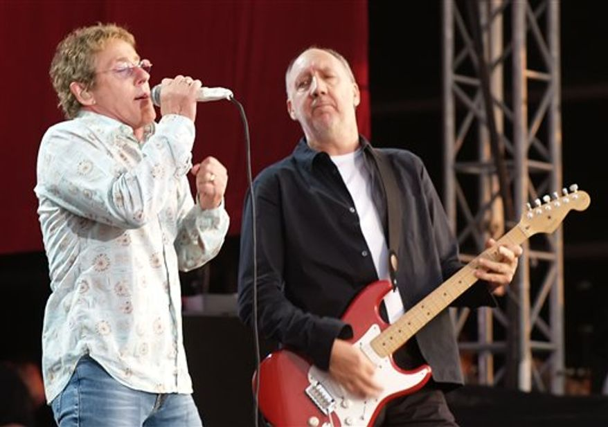 """** FILE ** In this July 2, 2006 photo, Roger Daltrey and Pete Townshend of The Who are shown during their performance at the Hyde Park Music Festival, in London. Daltrey and Townshend are taking """"Quadrophenia"""" and other Who classics on the road for a U.S. tour this fall, but first plan what Daltrey calls a great finale for the Olympic Games in London. (AP Photo/ Max Nash, File)"""
