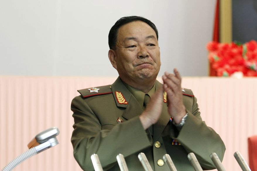 North Korean Vice Marshal Hyon Yong-chol applauds during a meeting at the April 25 House of Culture announcing North Korean leader Kim Jong-un's new title of marshal on Wednesday, July 18, 2012, in Pyongyang, North Korea. (AP Photo/Jon Chol Jin)
