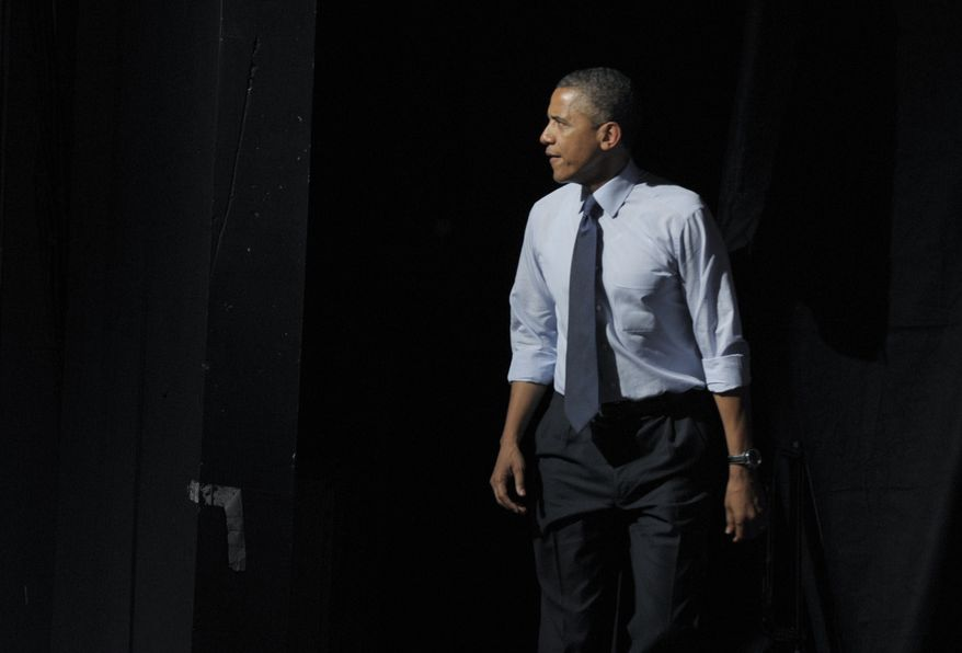 President Obama walks onstage to speak on Tuesday, July 17, 2012, at a fundraiser at the Austin Music Hall in Austin, Texas. (Associated Press)