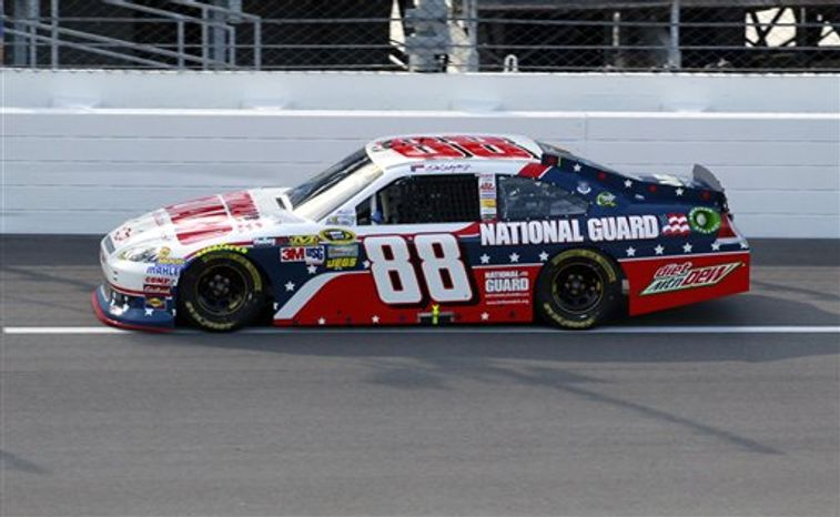 Dale Earnhardt Jr. makes a qualifying lap for the NASCAR Sprint Cup Series auto race at Daytona International Speedway, Friday, July 6, 2012, in Daytona Beach, Fla. (AP Photo/John Raoux)