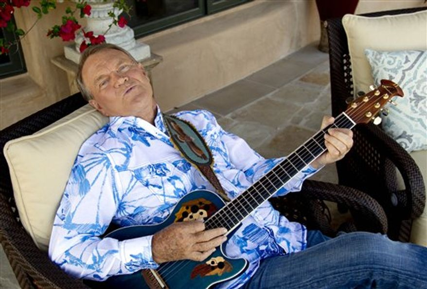 "This July 27, 2011 photo shows musician Glen Campbell in Malibu, Calif. . Campbell, who was diagnosed with Alzheimer's disease is planning a farewell tour before retiring from the music. Campbell is canceling the Australia and New Zealand stops of his ""Goodbye Tour"" with Kenny Rogers next month for health reasons. (AP Photo/Matt Sayles)"