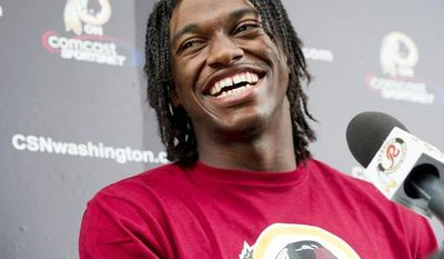 Robert Griffin III, aka RG3, told the media he felt good on the field during a press conference following Washington Redskins Rookie Minicamp at Redskins Park in Ahsburn, Va., on Sunday, May 6, 2012. He says he hopes to earn the respect of the veteran players when they return to start training camp. (Barbara L. Salisbury/The Washington Times)