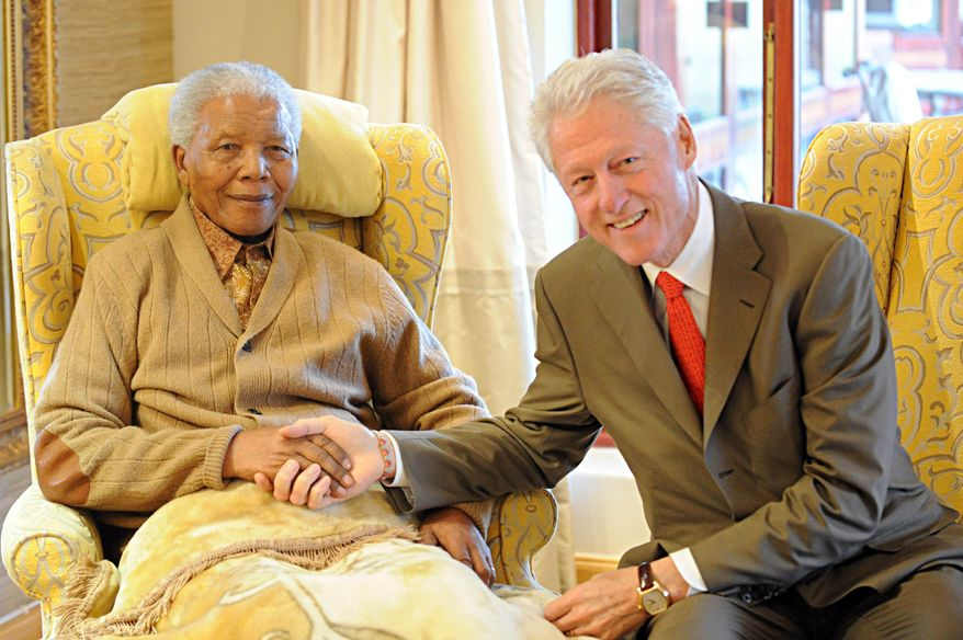 Former U.S. President Bill Clinton (right) meets with former South African President Nelson Mandela at the latter's home in Qunu, South Africa, on Tuesday, July 17, 2012, on the eve of Mr. Mandela's 94th birthday. (AP Photo/Peter Morey)