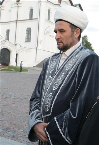 In this Thursday, July 14, 2011 file photo, Ildus Faizov, a top Muslim cleric in the Volga River province of Tatarstan, addresses Russia's then-premier Vladimir Putin, unseen, in Kazan, about 700 kilometers (450 miles) east of Moscow. Faizov, known for his criticism of radical Islamist groups known as Salafists, was wounded Thursday,J uly 19, 2012, after an explosive device ripped through his car in Kazan. (AP Photo/RIA No