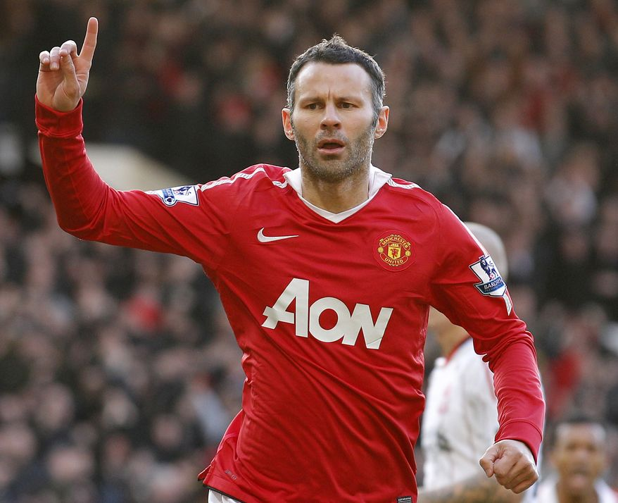 FILE - In this  Sunday Jan. 9, 2011 file photo Manchester United's Ryan Giggs celebrates after scoring a penalty goal against Liverpool during their English FA Cup soccer match at Old Trafford, Manchester, England. The British Olympic Association said Monday July 2, 2012  that Manchester United midfielder Ryan Giggs has been included in Britain's 18-man squad for the men's football tournament at the London Olympics, with head coach Stuart Pearce confirming the absence of David Beckham.  The 38-year-old Giggs joined fellow Welshman Craig Bellamy and England defender Micah Richards as the three overage players allowed in the squad, which will represent Britain at an Olympic Games for the first time since 1960.   (AP Photo/Jon Super, File)