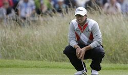 Adam Scott of Australia lines up a putt on the 17th green at Royal Lytham & St Annes golf club during the first round of the British Open Golf Championship, Lytham St Annes, England, Thursday, July 19, 2012. (AP Photo/Chris Carlson)